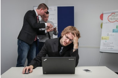Stressed man looking at computer